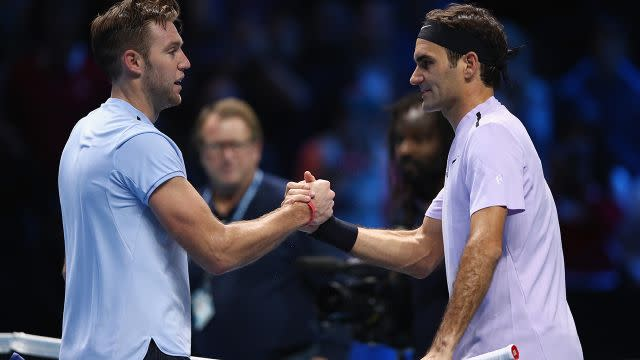 Sock (left) and Federer after the match. Image: Getty