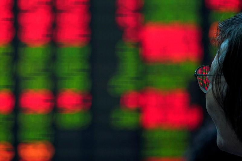 World shares mixed as China affirms trade talks to go ahead