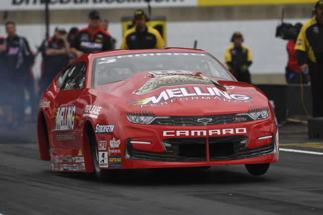 In this photo provided by the NHRA, Pro Stock's Erica Enders makes a pass to land the provisional No. 1 qualifier position Friday, Sept. 13, 2019, at the annual Mopar Express Lane NHRA Nationals in Mohnton, Pa. (Marc Gewertz/NHRA via AP)