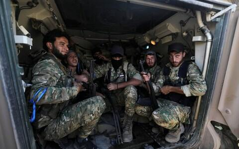 The Syrian rebels take arms and directions from Turkey - Credit: REUTERS/Khalil Ashawi