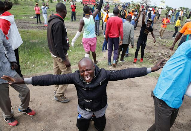 <p>A supporter of Kenyan opposition leader Raila Odinga of the National Super Alliance (NASA) coalition reacts as he attempts to access the Jomo Kenyatta airport upon Odinga's return in Nairobi, Kenya, Nov. 17, 2017. (Photo: Baz Ratner/Reuters) </p>
