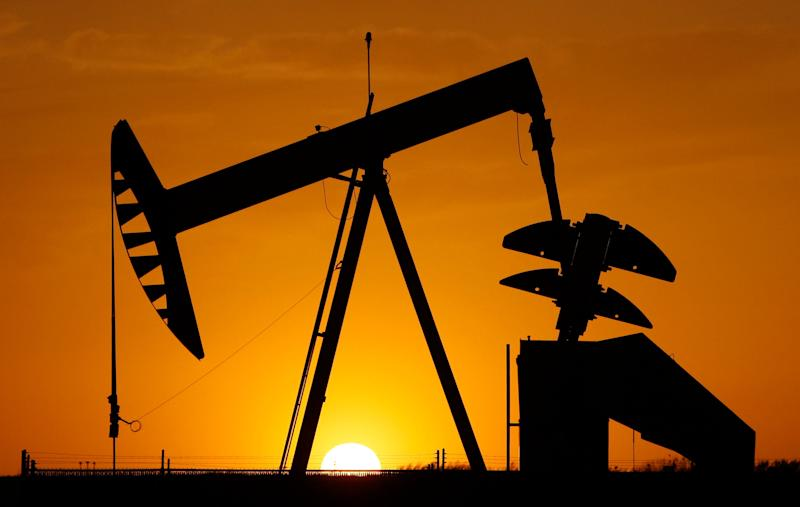 A pumpjack is silhouetted against the setting sun in Oklahoma City. (AP Photo/Sue Ogrocki, File)