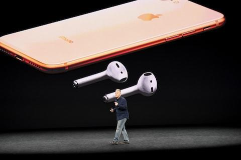Apple hasn't brought the headphone jack back, but will work with the company's AirPods - Credit: Bloomberg