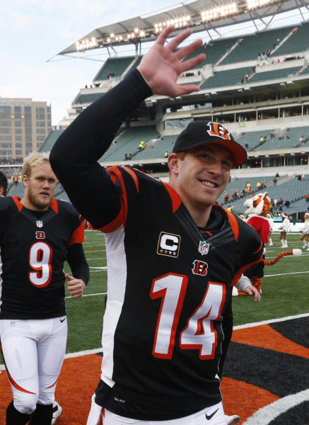Cincinnati Bengals quarterback Andy Dalton (14) leaves the field after the Bengals defeated the Minnesota Vikings 42-14 in an NFL football game, Sunday, Dec. 22, 2013, in Cincinnati. Dalton threw four touchdown passes. (AP Photo/David Kohl)