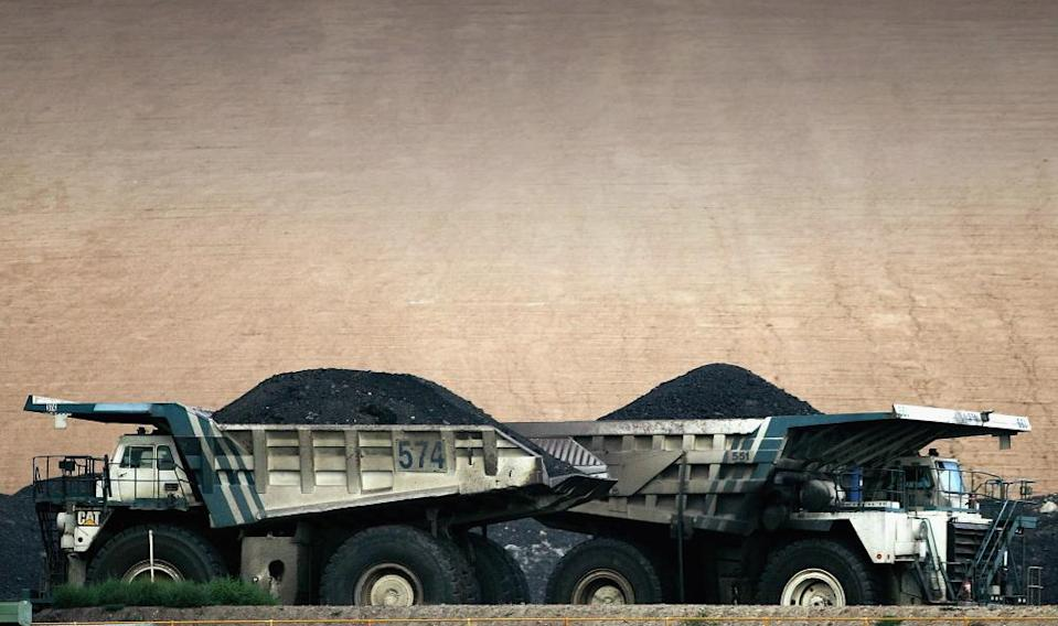 Coal trucks pass each other at BHP Billiton's Mount Arthur coal mine in Muswellbrook.