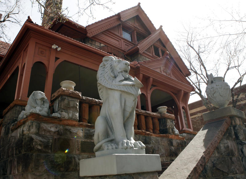 """This March 12, 2012 photo shows lions guarding the front of the Molly Brown House Museum in Denver. A few blocks from Colorado's state Capitol _ over 1700 miles from the Atlantic Ocean and a mile above sea level _ is a museum dedicated to a woman eclipsed by legend following the sinking of the Titantic. The """"unsinkable Molly Brown"""" moved into this stone Victorian home after she and her husband struck it rich at a gold mine in Colorado's mountains, nearly 20 years before she boarded the Titanic because it was the first boat she could get back home to visit her ailing grandson. (AP Photo/Ed Andrieski)"""