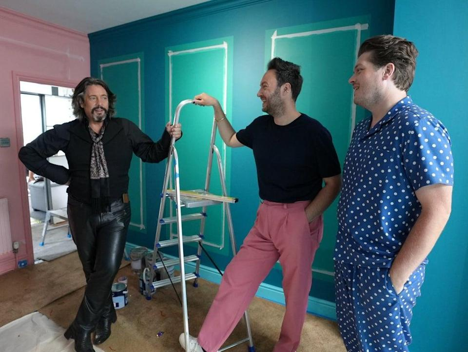 Part dandy highwayman, part sex dungeon captive: Laurence Llewelyn-Bowen amuses Jordan Cluroe and Russell Whitehead in the rebooted 'Changing Rooms' (Channel 4)