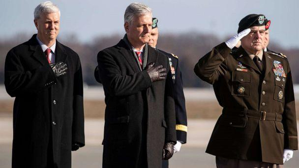 PHOTO: National Security Adviser Robert O'Brien, Joint Chiefs Chairman Gen. Mark Milley, and others stand as a dignified transfer of remains occurs, Dec. 25, 2019, at Dover Air Force Base, Del. (Alex Brandon/AP, FILE)