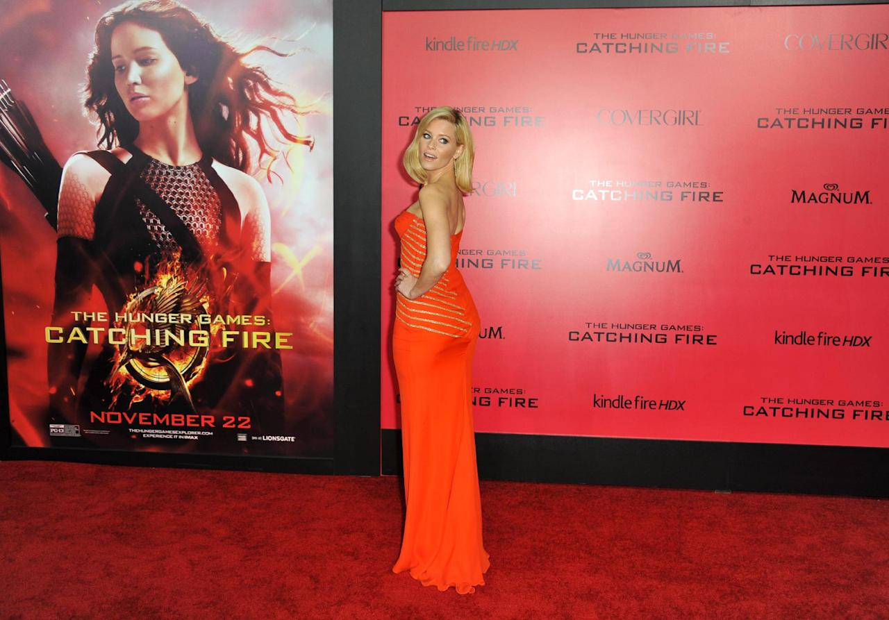 """Elizabeth Banks arrives at the Los Angeles premiere of """"The Hunger Games: Catching Fire"""" at Nokia Theatre LA Live on Monday, Nov. 18, 2013. (Photo by Jordan Strauss/Invision/AP)"""