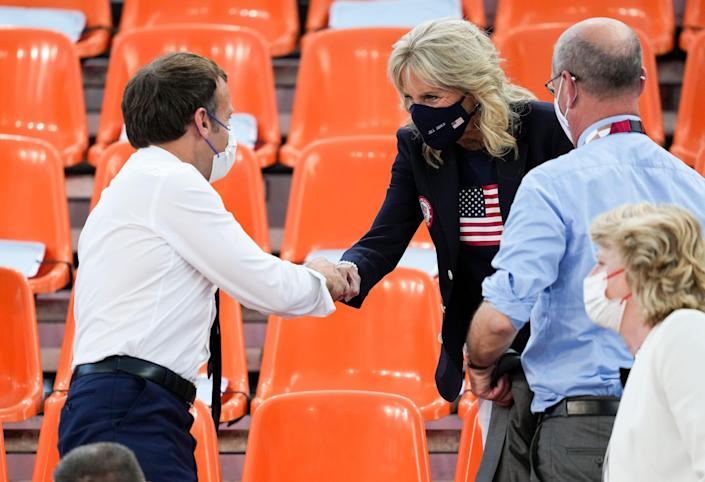 French President Emmanuel Macron greets First Lady Jill Biden before a 3x3 basketball game between France and the USA during the Tokyo 2020 Olympic Summer Games at Aomi Urban Sports Park on July 24.