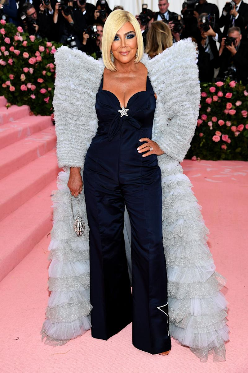 Kris Jenner stunned everyone at an event when she appeared in a dark-blue color jumpsuit with a fury and shiny jacket.