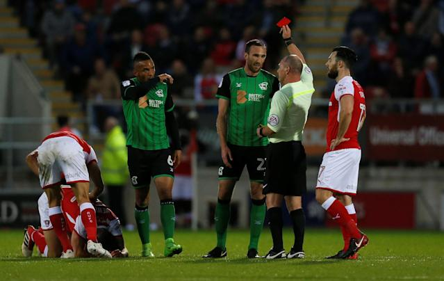 "Soccer Football - League One Play Off Semi Final Second Leg - Rotherham United vs Scunthorpe United - AESSEAL New York Stadium, Rotherham, Britain - May 16, 2018 Scunthorpe United's Rory McArdle is shown a red card by referee Scott Duncan Action Images/Ed Sykes EDITORIAL USE ONLY. No use with unauthorized audio, video, data, fixture lists, club/league logos or ""live"" services. Online in-match use limited to 75 images, no video emulation. No use in betting, games or single club/league/player publications. Please contact your account representative for further details."