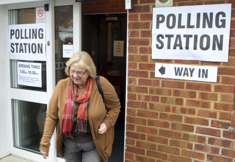 A resident leaves the polling station after casting her vote in the Eastleigh by-election  in West End, Hampshire, southern England Thursday Feb. 28, 2013. Britain's political parties are contesting a special election after a campaign overshadowed by scandals, including the criminal conviction of a former Cabinet minister and allegations of sexual misconduct against a party official.(AP Photo/Steve Parsons/PA) UNITED KINGDOM OUT - NO SALES - NO ARCHIVES