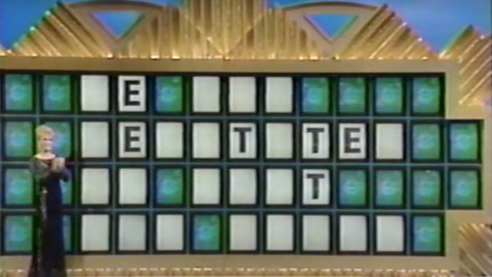 Vanna White stands next to a clue on the Wheel of Fortune board during Matthew Fenwick's episode.