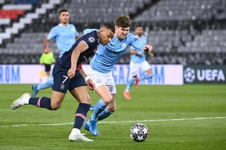 John Stones (right) helped keep PSG star duo Kylian Mbappe (left) and Neymar quiet
