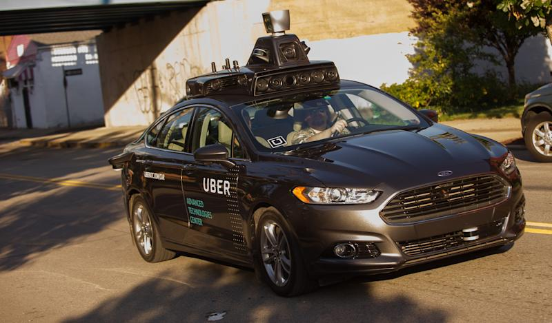 An Uber autonomous Ford Fusion drives through Pittsburgh in September 2016. The company, which now partners with Volvo, currently picks up and drops off riders from self-driving vehicles in only nine of Pittsburgh's 90 neighborhoods. (Jeff Swensen/Getty Images)