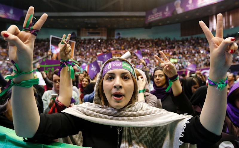 A female supporter of Iran's President Hassan Rouhani attends a campaign rally in the capital Tehran on May 13, 2017 as he runs for re-election (AFP Photo/ATTA KENARE)