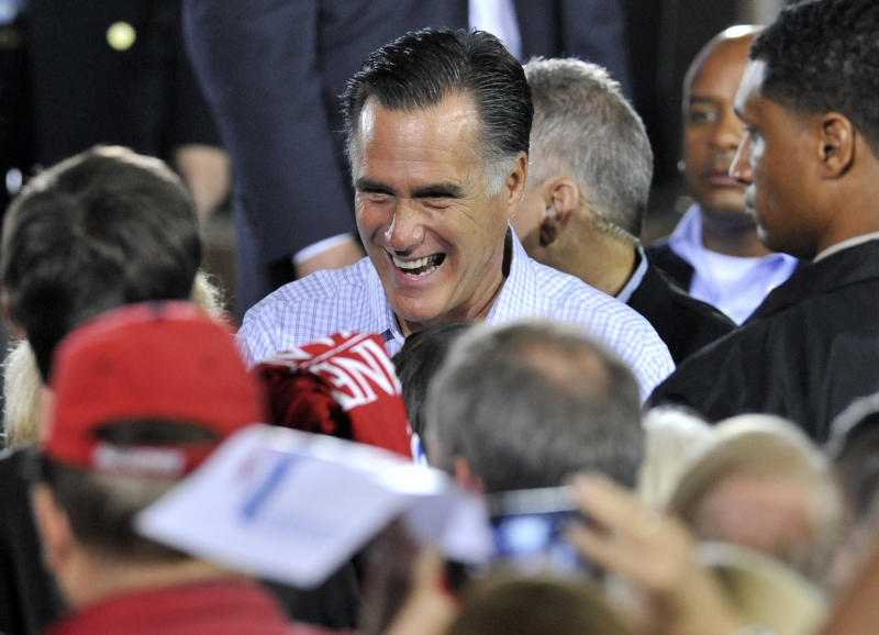 Republican presidential candidate, former Massachusetts Gov. Mitt Romney talks with supporters during a campaign stop at American Spring Wire, Wednesday, Sept. 26, 2012, in Bedford Heights, Ohio.  (AP Photo/ David Richard)