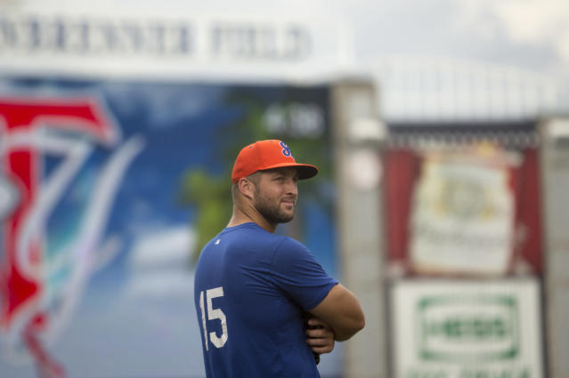 Tim Tebow stayed in the game after taking a pitch to the head. (Charlie Kaijo/Tampa Bay Times via AP)