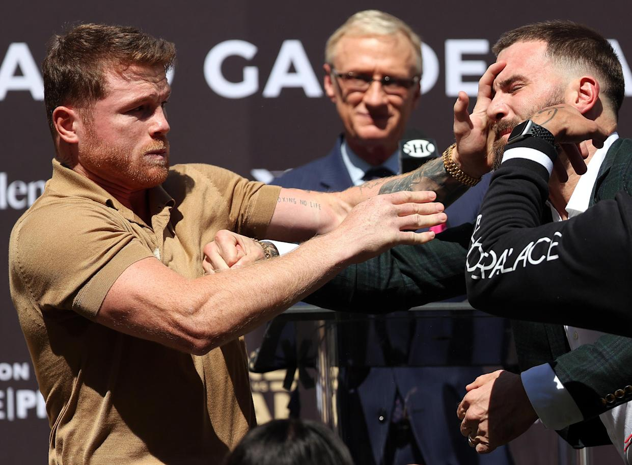 BEVERLY HILLS, CALIFORNIA - SEPTEMBER 21:  (L-R) Canelo Alvarez slaps Caleb Plant during a face-off before a press conference ahead of their super middleweight fight on November 6 at The Beverly Hilton on September 21, 2021 in Beverly Hills, California. (Photo by Ronald Martinez/Getty Images)