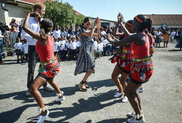 Royal moves: The duke and duchess with dancers at the Justice Desk, an NGO in Cape Town's rundown Nyanga district (AFP Photo/Courtney AFRICA)