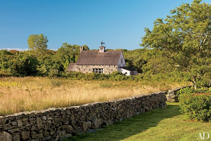 """Originally built in Ontario, this <a rel=""""nofollow"""" href=""""http://www.architecturaldigest.com/story/grickis-article?mbid=synd_yahoo_rss"""">200-plus-year-old barn</a> was later relocated to an arcadian four-acre parcel in Rhode Island, where designer Ellen Denisevich-Grickis refurbished it as a summer home for her family. The renovation included cladding part of the structure in stone—an homage to local farmhouses as well as the stone walls that line the property."""
