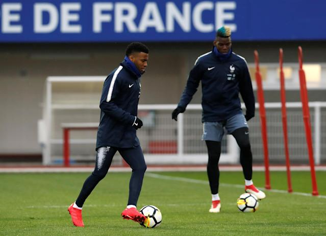 Soccer Football - France Training - Clairefontaine, France - March 19, 2018 France's Thomas Lemar and Paul Pogba during training REUTERS/Gonzalo Fuentes