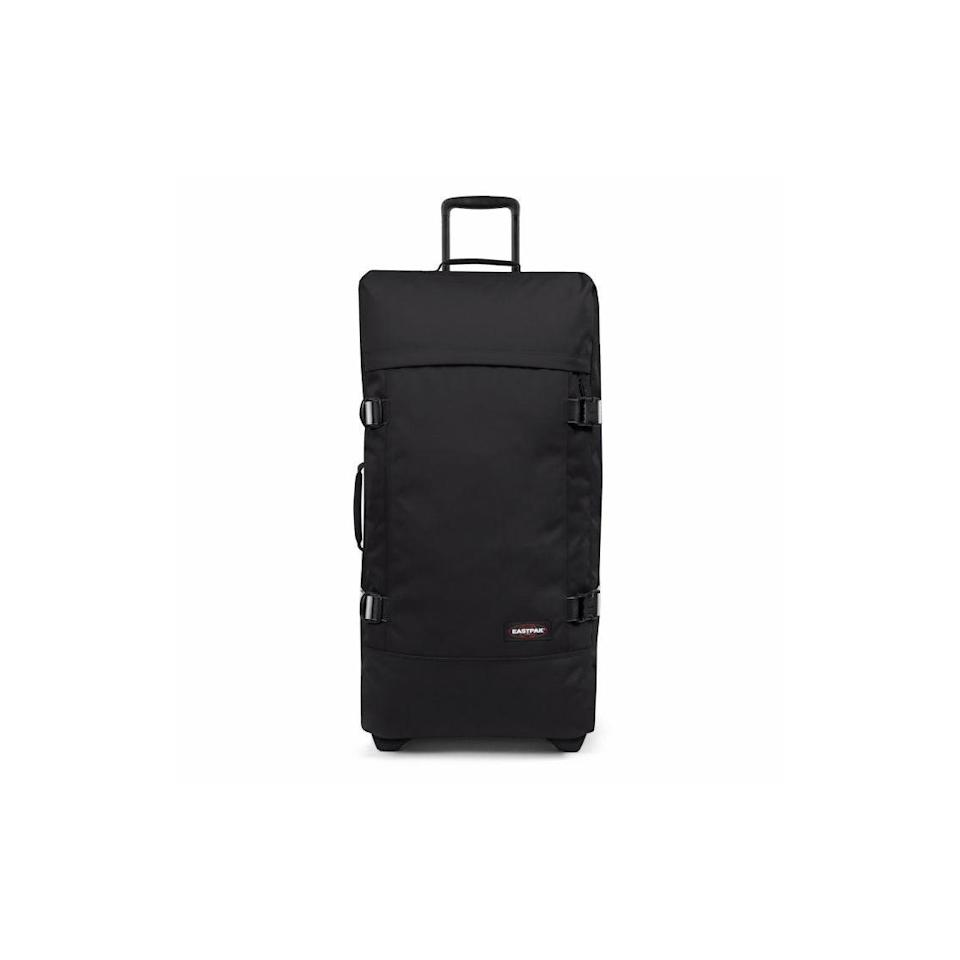 """<p><a class=""""link rapid-noclick-resp"""" href=""""https://go.redirectingat.com?id=127X1599956&url=https%3A%2F%2Fwww.eastpak.com%2Fuk-en%2Fluggage-c140%2Ftranverz-l-blakout-bw-pEK63L62X%2B00%2B999.html&sref=https%3A%2F%2Fwww.cosmopolitan.com%2Fuk%2Fentertainment%2Ftravel%2Fg28101108%2Flarge-suitcase%2F"""" rel=""""nofollow noopener"""" target=""""_blank"""" data-ylk=""""slk:BUY NOW"""">BUY NOW</a> <strong>£150</strong></p><p>You'll love Eastpak's 79cm Tranverz suitcase if you're short on space at home as it packs away flat but still comes with all the features you want from your checked in luggage: telescopic handle, wheels and even compression straps so you can pack more into the case.</p>"""