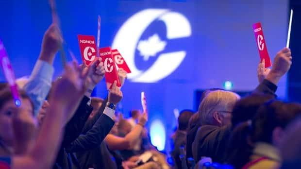 Delegates vote on party constitution items at the Conservative Party of Canada national policy convention in Halifax on Friday.