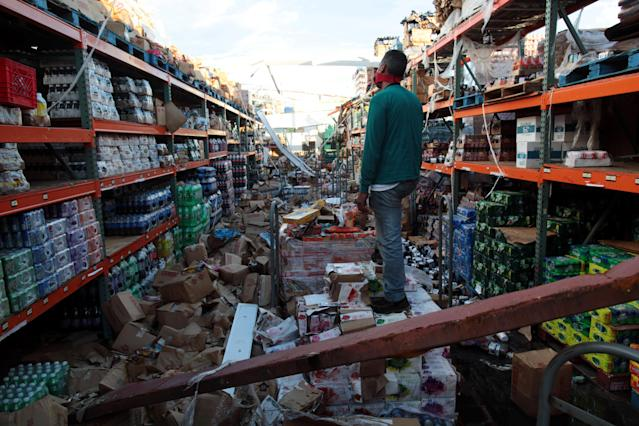 <p>A man stands inside of a destroyed supermarket by Hurricane Maria in Salinas, Puerto Rico, Sept. 29, 2017. (Photo: Alvin Baez/Reuters) </p>