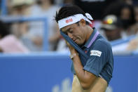 Kei Nishikori, of Japan, wipes his face during a match against Sam Querrey. of the United States, in the Citi Open tennis tournament Monday, Aug. 2, 2021, in Washington. (AP Photo/Nick Wass)