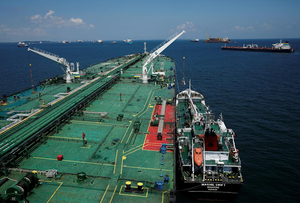 REFILE - CORRECTING TYPO IN SUPERTANKER'S NAME A bunker vessel prepares to supply fuel to Hin Leong's Pu Tuo San VLCC supertanker in the waters off Jurong Island in Singapore July 11, 2019.  Picture taken July 11, 2019.  REUTERS/Edgar Su
