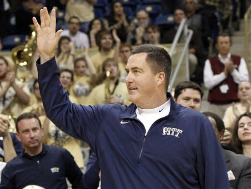 Pittsburgh's new football coach, Paul Chryst, waves during his instrodution to the crowd during a timeout in the first half of the NCAA college basketball game between Pittsburgh and Rutgers on Wednesday, Jan. 11, 2012, in Pittsburgh. (AP Photo/Keith Srakocic)