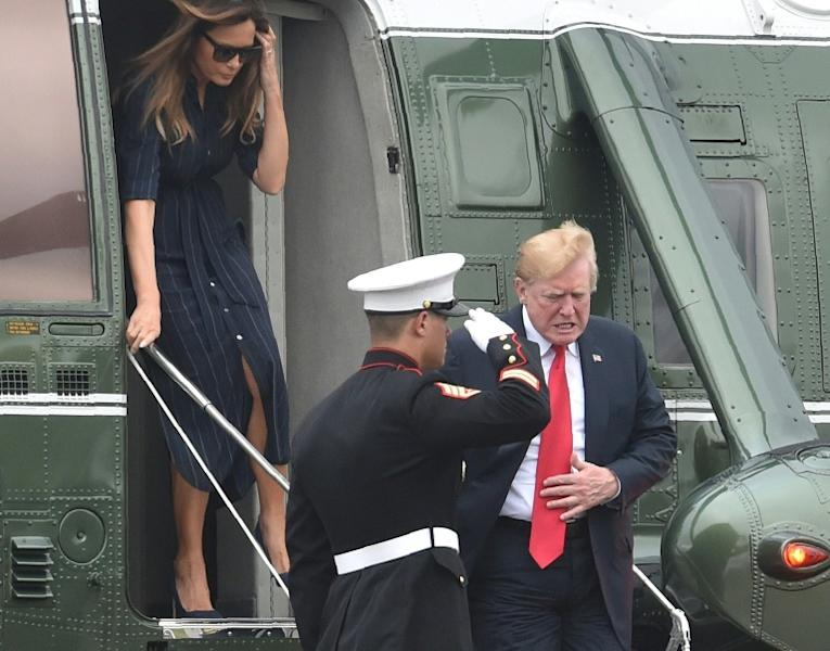 US President Donald Trump and first lady Melania Trump disembark the Marine One helicopter on Sunday, before he issued a warning to Iran
