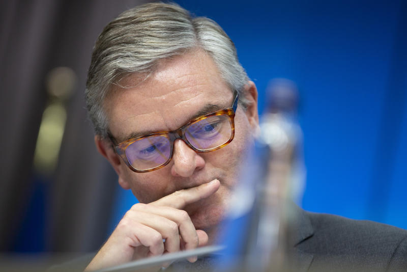 European Commissioner for Security Union Julian King pauses before speaking during a media conference for the Presidency press release on member states' report on EU coordinated risk assessment of 5G network security at the European Council building in Brussels, Wednesday, Oct. 9, 2019. (AP Photo/Virginia Mayo)