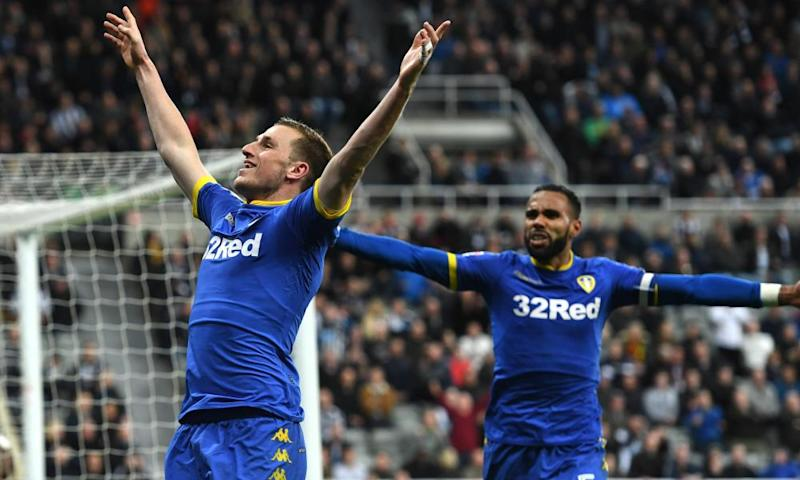 Chris Wood celebrates scoring his stoppage time equaliser for Leeds against Newcastle.
