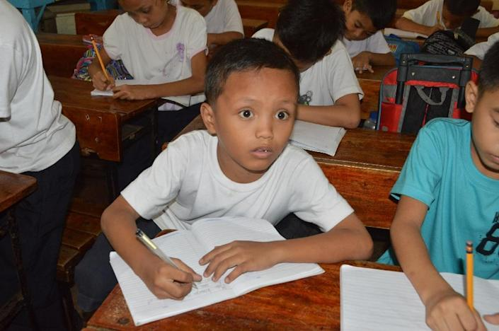 Nine-year-old homeless boy Daniel Cabrera attends class at a school in Mandaue City, central Philippines (AFP Photo/)