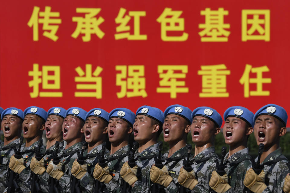 FILE - In this Sept. 25, 2019, file photo, soldiers practice marching in formation ahead of the military parade to celebrate the 70th anniversary of the founding of the People's Republic of China in Beijing. Japan's annual defense paper, approved Friday, Sept. 27, 2019, says Defense Ministry highlighted space security as priority, citing growing space activity by China and Russia as threats. (Naohiko Hatta/Pool Photo via AP, File)