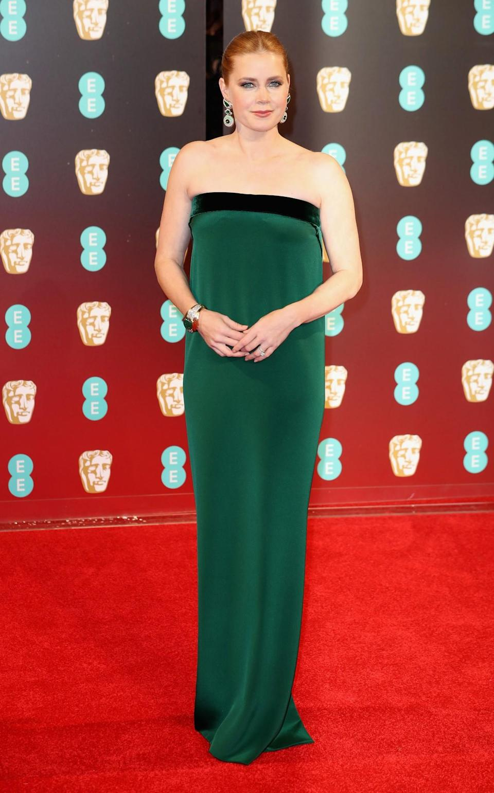 <p>Amy donned a strapless emerald green number by Tom Ford. <i>[Photo: Getty]</i> </p>