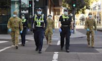 Police and soldiers are patrolling Melbourne as part of new restrictions against an upswing in infections