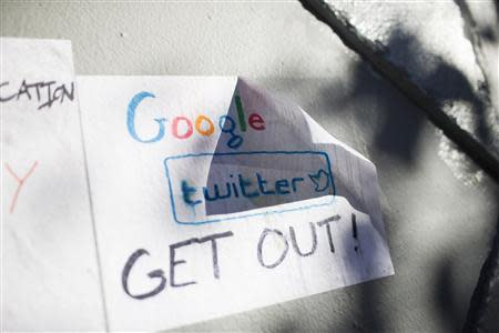 Signs in opposition of technology companies are seen in San Francisco, California December 9, 2013. REUTERS/Stephen Lam