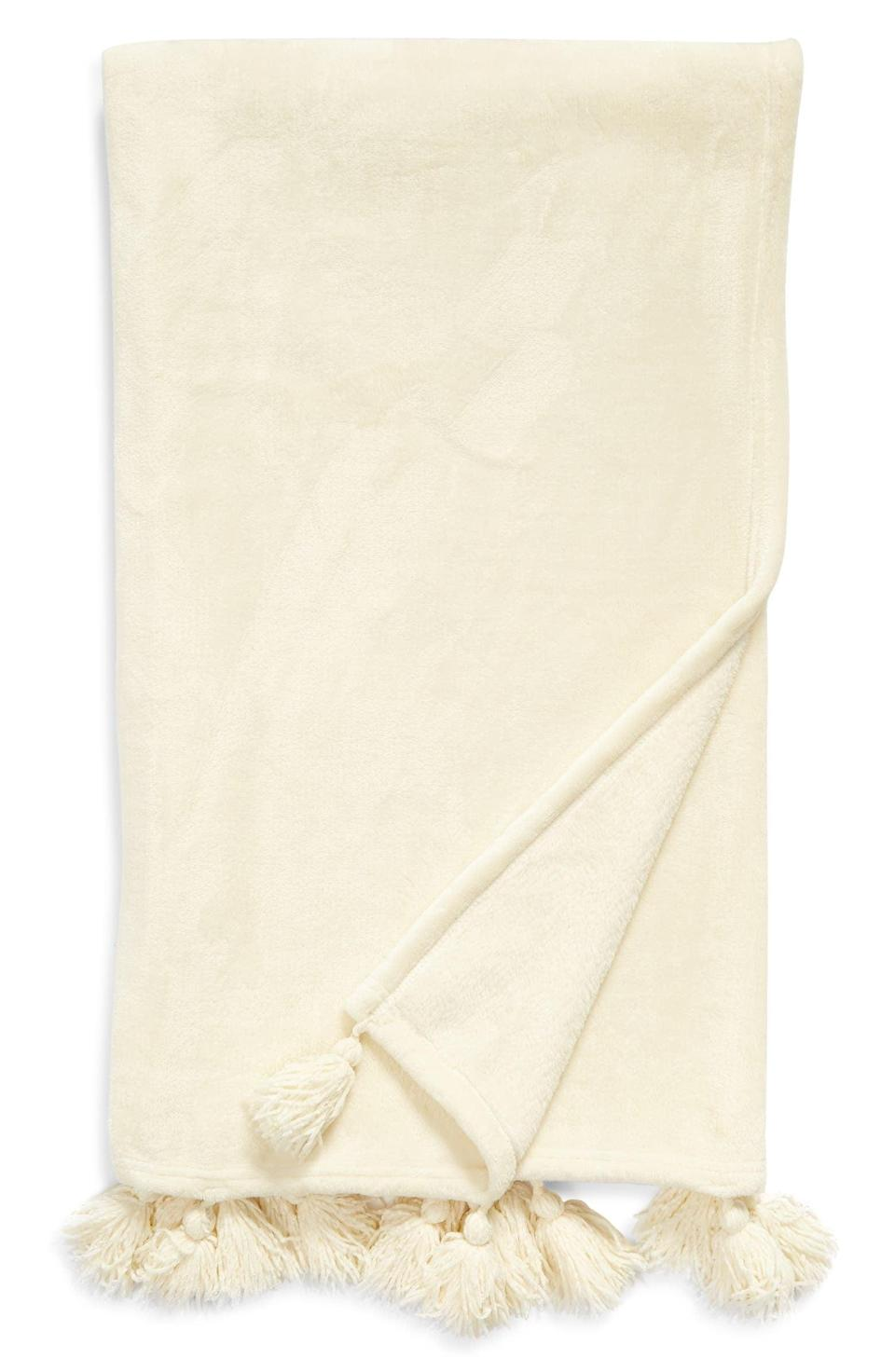 <p>Get this <span>Nordstrom Bliss Plush Tassel Throw</span> ($20, originally $40) for someone who loves home decor.</p>