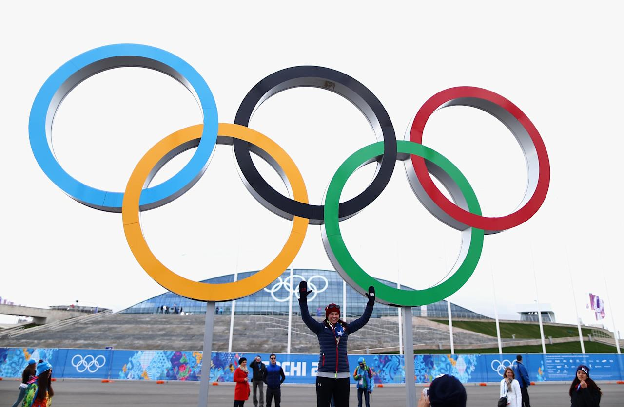 SOCHI, RUSSIA - FEBRUARY 05: Speed skater Brittany Bowe poses in front of the Olympic rings ahead of the Sochi 2014 Winter Olympics at the Olympic Park on February 5, 2014 in Sochi, Russia. (Photo by Clive Mason/Getty Images)