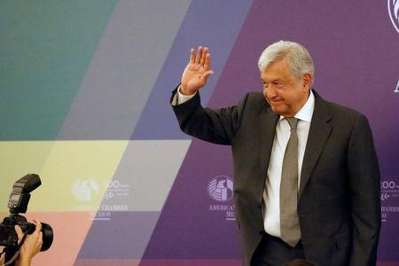 Leftist front-runner Lopez Obrador of MORENA waves after a meeting with the American Chamber Mexico in Mexico City