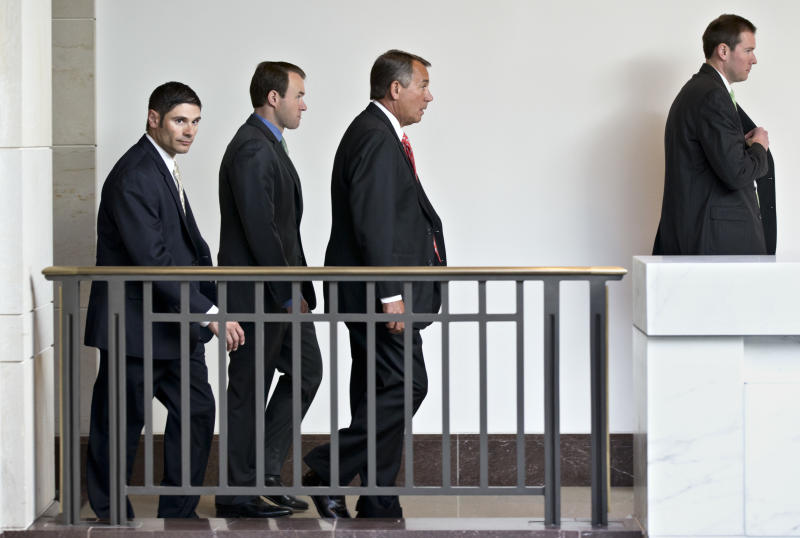 """House Speaker House John Boehner of Ohio, center, leaves a news conference on Capitol Hill in Washington, Thursday, Nov. 29, 2012, after reporting on his private talks with Treasury Secretary Timothy Geithner on the fiscal cliff negotiations. """"No substantive progress has been made between the White House and the House"""" in the past two weeks, Boehner said. The """"fiscal cliff"""" is a combination of tax increases and spending cuts worth about $670 billion that will take effect at the start of next year unless Congress and the White House agree to postpone or replace them.  (AP Photo/J. Scott Applewhite)"""