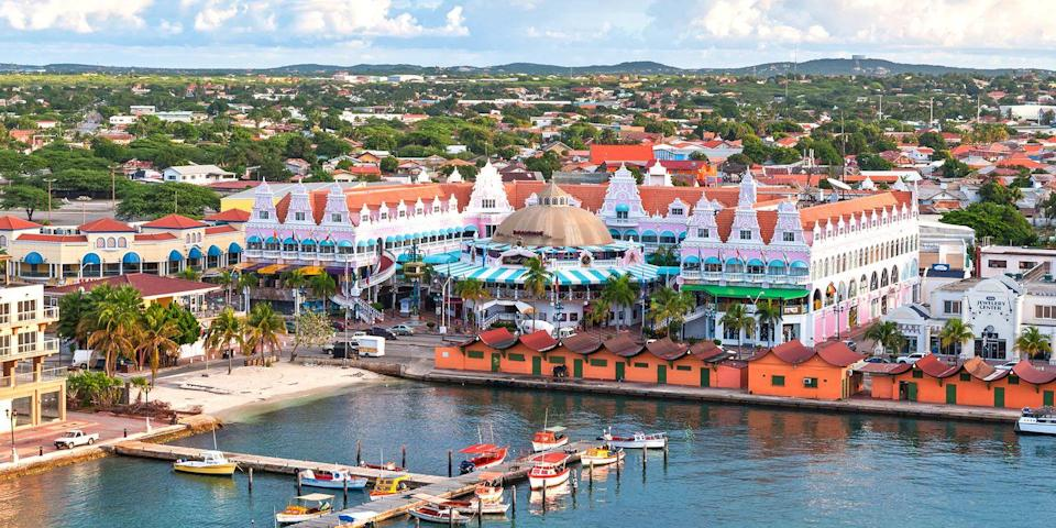 """<p><a rel=""""nofollow noopener"""" href=""""https://www.bestproducts.com/fun-things-to-do/g3121/best-aruba-hotels/"""" target=""""_blank"""" data-ylk=""""slk:Aruba"""" class=""""link rapid-noclick-resp"""">Aruba</a>, the A in the ABC islands (along Bonaire and Curaçao) has plenty more to offer than just pretty beaches. In the capital of Oranjestad, you'll find duty-free shopping and gourmet restaurants, while its arid interior has rock formations and prehistoric caves. Throw in golf courses, buzzing casinos, and <a rel=""""nofollow noopener"""" href=""""https://www.bestproducts.com/fun-things-to-do/g2556/best-all-inclusive-resort-vacations/"""" target=""""_blank"""" data-ylk=""""slk:all-inclusive resorts"""" class=""""link rapid-noclick-resp"""">all-inclusive resorts</a> - and you have one of the Caribbean's most well-rounded islands. </p>"""
