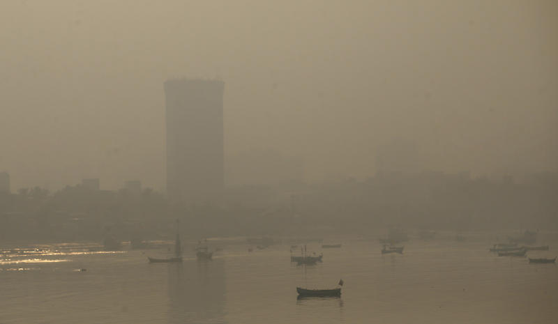 Morning smog envelops the skyline in Mumbai, India, Friday, Oct. 20, 2017. Environmental pollutants are killing at least 9 million people and costing the world $4.6 trillion a year, a toll exceeding that of wars, smoking, hunger or natural disasters, according to a study released Thursday in The Lancet medical journal. (AP Photo/Rafiq Maqbool)