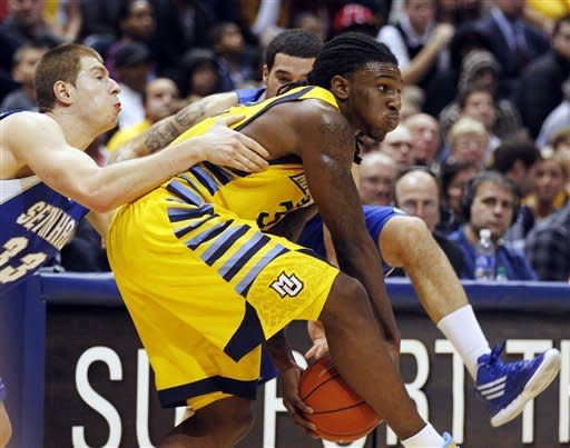 Seton Hall's Patrik Auda fouls Marquette's Jae Crowder during the second half of an NCAA college basketball game, Tuesday, Jan. 31, 2012, in Milwaukee. Marquette won 66-59. (AP Photo/Jeffrey Phelps)