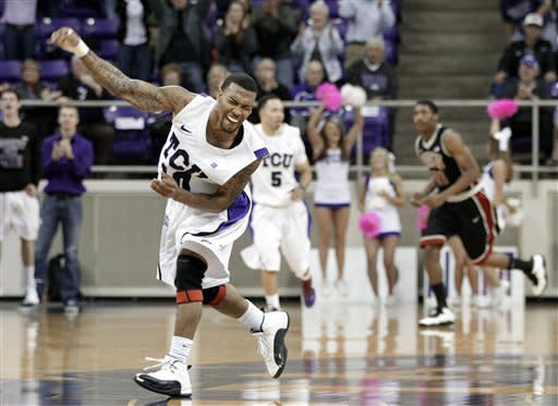 TCU 's Hank Thorns celebrates making a basket against UNLV late in the second half of an NCAA college basketball game on Tuesday, Feb. 14, 2012, in Fort Worth, Texas. Thorns led scoring with 32-points in the 102-97 victory over UNLV. (AP Photo/Tony Gutierrez)