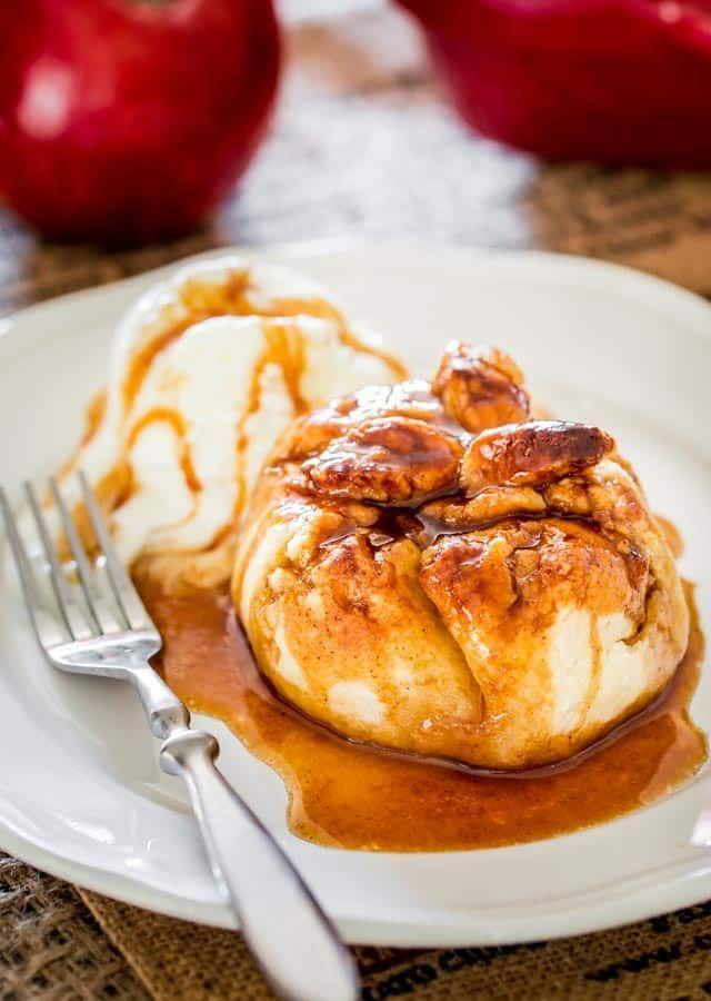 "<p>Talk about comfort food! These flaky apple dumplings are served with a delicious, sticky syrup, which may quickly make them a family favorite.</p><p><strong>Get the recipe at <a href=""https://www.jocooks.com/baking/pastries/apple-dumplings/"" rel=""nofollow noopener"" target=""_blank"" data-ylk=""slk:Jo Cooks"" class=""link rapid-noclick-resp"">Jo Cooks</a>.</strong></p><p><strong><a class=""link rapid-noclick-resp"" href=""https://www.amazon.com/dp/B0054QKCXA/?tag=syn-yahoo-20&ascsubtag=%5Bartid%7C10050.g.650%5Bsrc%7Cyahoo-us"" rel=""nofollow noopener"" target=""_blank"" data-ylk=""slk:SHOP CARAMEL SAUCE"">SHOP CARAMEL SAUCE</a></strong></p>"